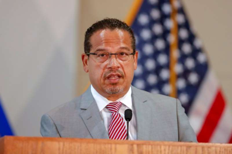 Keith Ellison wearing a suit and tie: FILE PHOTO: Minnesota Attorney General Ellison announces charges against former police officers involved in Floyd death