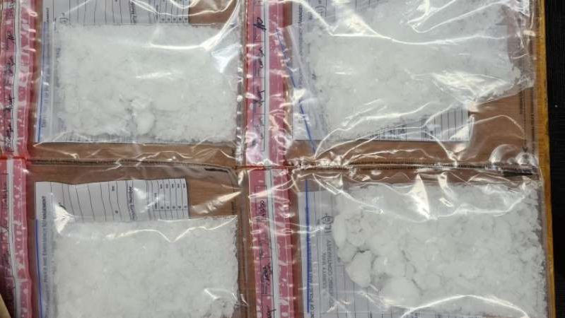 a plastic bag: Tasmania Police said the ice was allegedly concealed in mail packages. (Supplied: Tasmania Police)