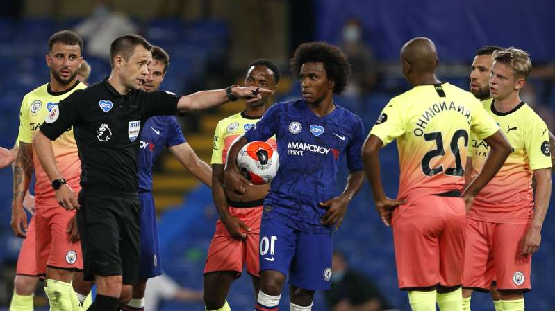 Oleksandr Zinchenko, Willian, Kyle Walker are posing for a picture: Willian waits to take his match-winning penalty