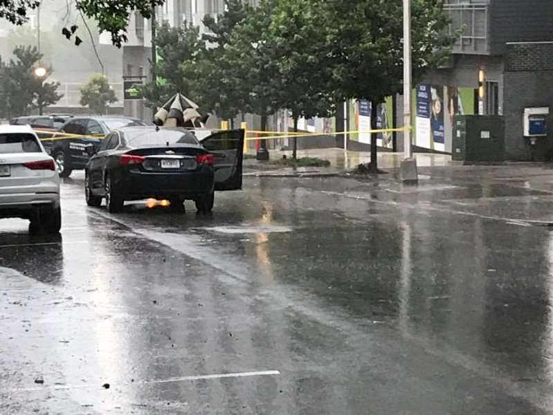 a car driving on a rainy day