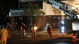 a group of people walking down a street: Firefighters were called to a building on Fleury Street, near the corner of Meunier Street, at around 1:30 a.m. Monday in Ahuntsic-Cartierville.