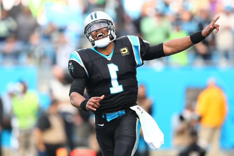 a person standing in front of a crowd: Cam Newton joins the Patriots after nine seasons with the Panthers.