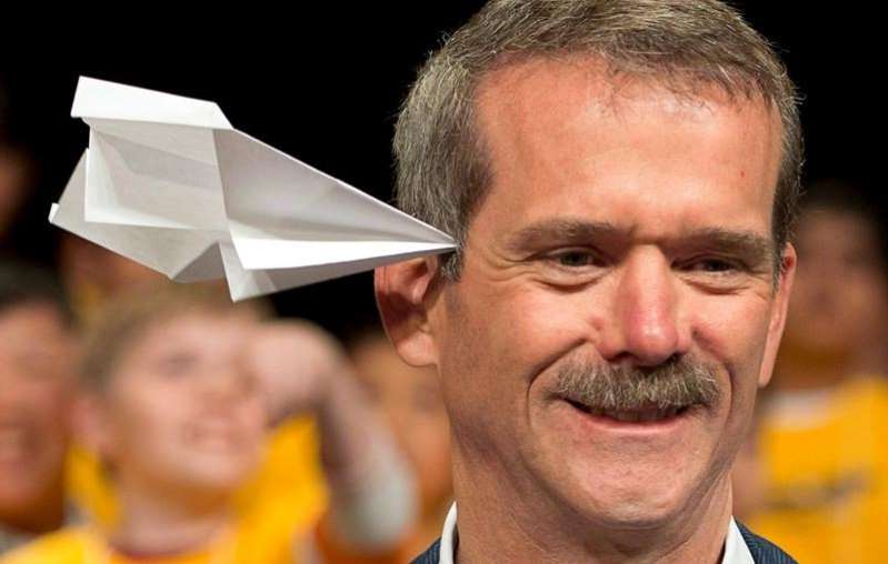 Chris Hadfield wearing glasses and smiling at the camera