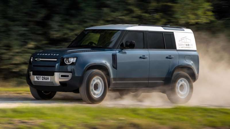 a car parked on the side of a road: 2020 Land Rover Defender 110 Hard Top - front 3/4 dynamic