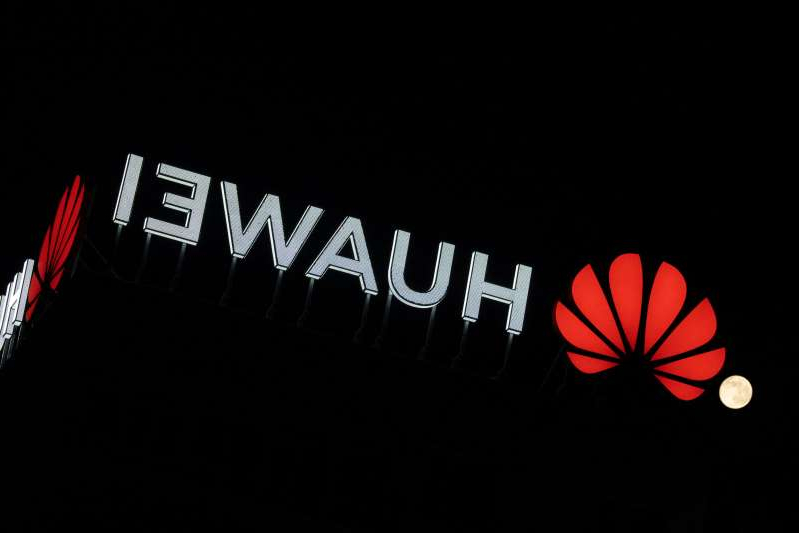 a close up of a logo: The Huawei logo is seen atop a buildin in central Warsaw, Poland on April 8, 2020. Chinese Huawei is the largest telecommunications company in the world and the second largest mobile phone manufacturer in the world after Samsung. In January 2019 a Huawei employee in Poland had been arrested on charges of espionage at the local offices of the company in Warsaw. Huawei says it has won a quarter of all 5G contracts all around the world despite worries of security leaks involving