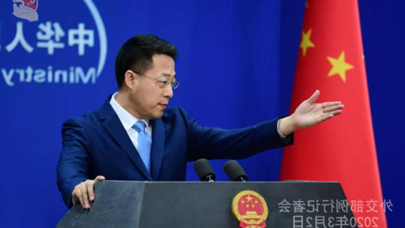 a man wearing a suit and tie: Chinese Foreign Ministry spokesman Zhao Lijian said there was