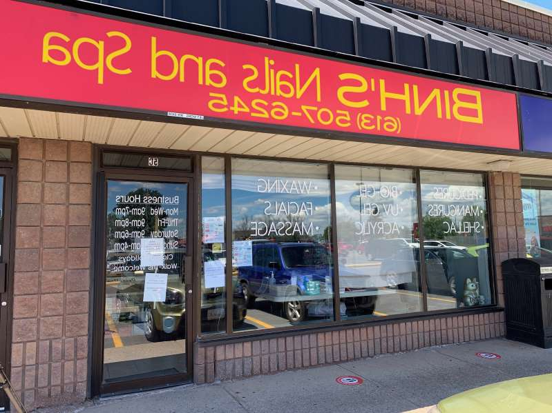 a sign above a store: Kingston police are investigating claims that two nail salons were operating before Stage 2 reopening in the region, including Binh's Nail Salon, which is the source of 30 COVID-19 infections