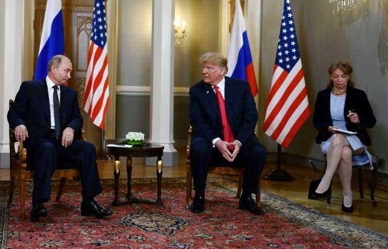 Donald Trump et al. standing in a room: Russian President Vladimir Putin and US President Donald Trump at a July 2018 summit in Helsinki where Trump controversially acknowledged Putin's denials of election meddling
