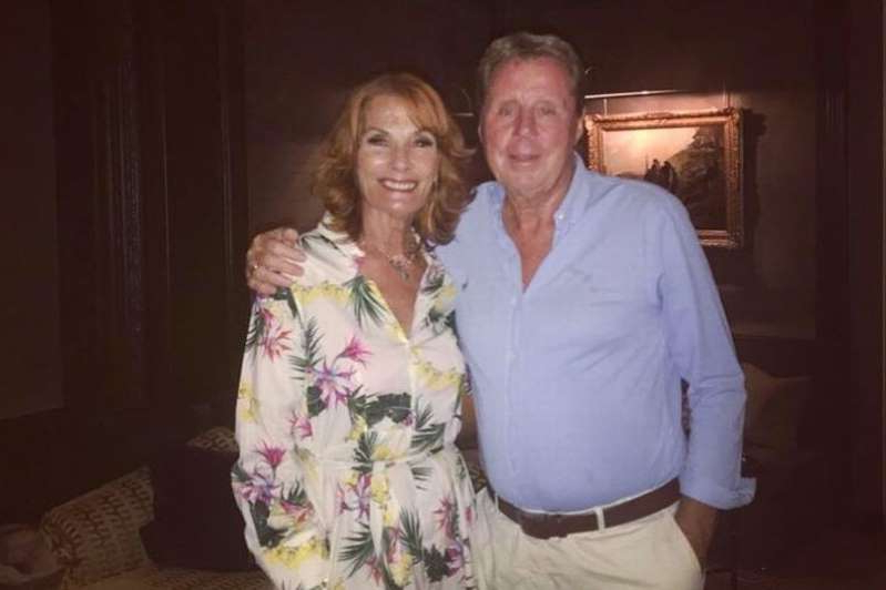 Harry Redknapp et al. posing for a picture: Harry Redknapp has posted a tear-jerking tribute to his beloved wife Sandra on their 52nd wedding anniversary