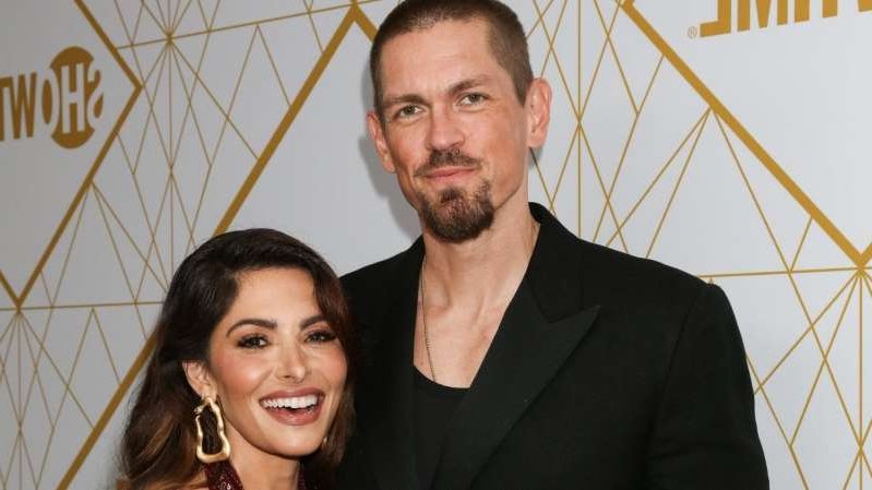 Steve Howey, Sarah Shahi are posing for a picture