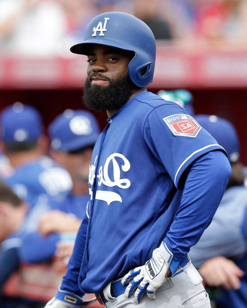 a baseball player holding a bat: Andrew Toles did not play in the majors last season.