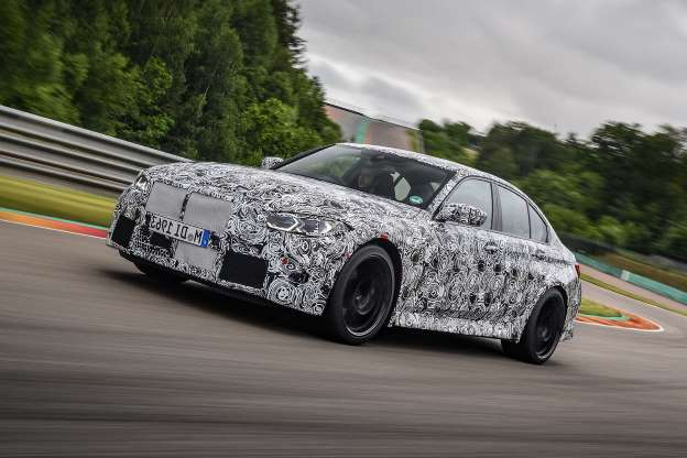 a car on the road: First drive: 2020 BMW M3 prototype
