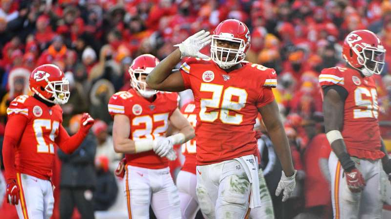 a group of baseball players standing on top of each other: Kansas City Chiefs defensive tackle Chris Jones (95) celebrates after a play during the game against the Tennessee Titans at Arrowhead Stadium.