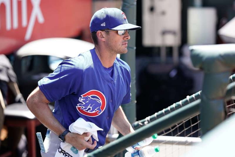 a man wearing a baseball hat: Chicago Cubs pitching coach Tommy Hottovy has already dealt with testing positive for the coronavirus.