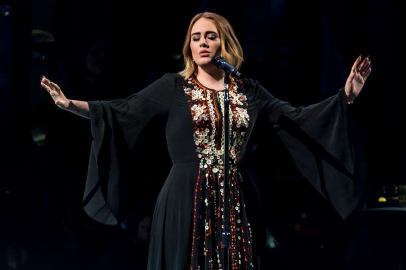 Adele wearing a dress: It took over 200 hours to make.