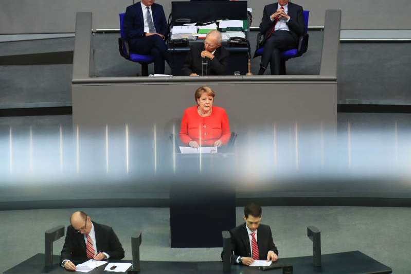 Angela Merkel et al. in a room: Germany's Chancellor Angela Merkel Addresses Bundestag