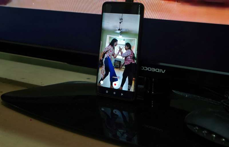 Geetha Sridhar and her daughter Sarada Sridhar are seen in a mobile phone's screen as they make a video, in Mumbai