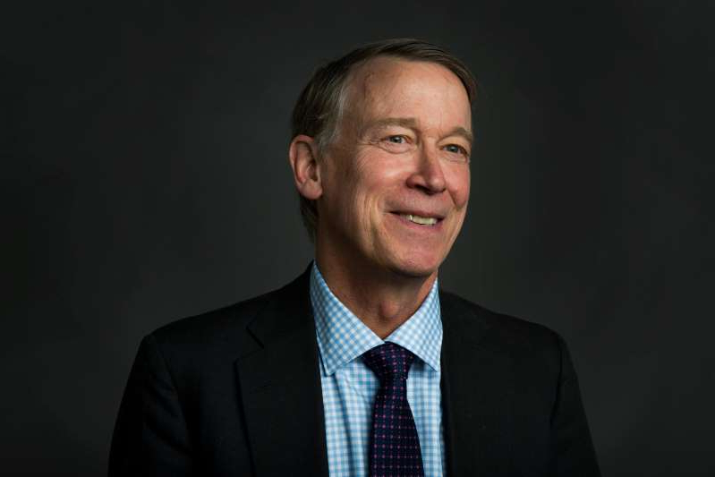 John Hickenlooper wearing a suit and tie: Colorado Governor John Hickenlooper poses for a portrait during a visit to the Coloradoan newsroom on Monday, October 15, 2018.