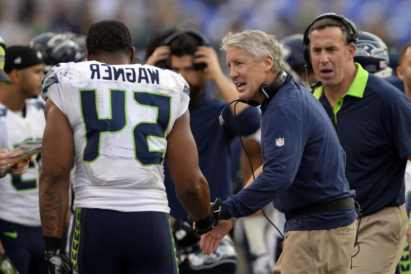 Pete Carroll et al. standing in front of a crowd: USA TODAY