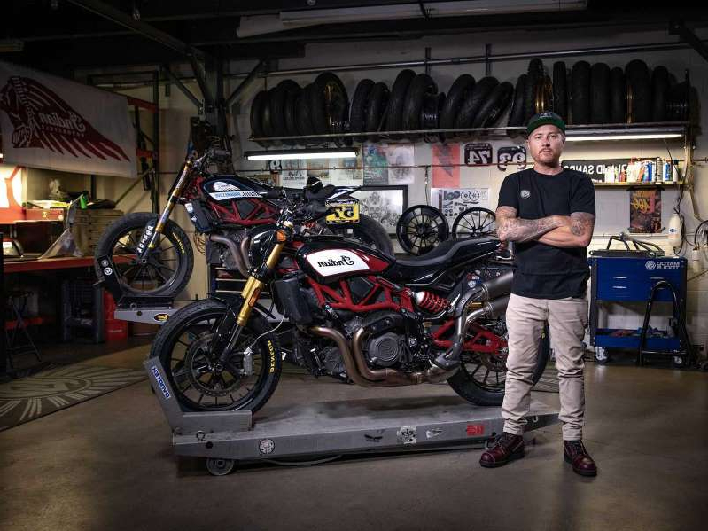 Roland Sands et al. standing around a motorcycle: Thanks to the FTR x Roland Sands Design Collection, you now have new accessory options for your FTR.