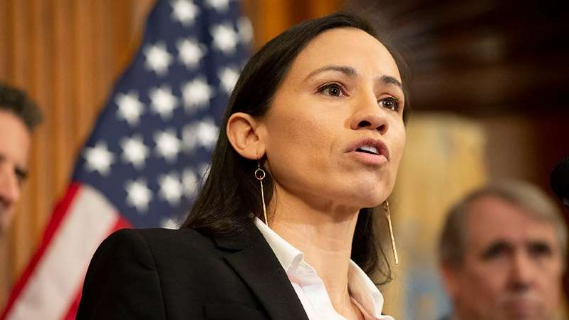 Sharice Davids wearing a suit and tie: Democratic lawmakers call for expanding, enshrining LGBTQ rights