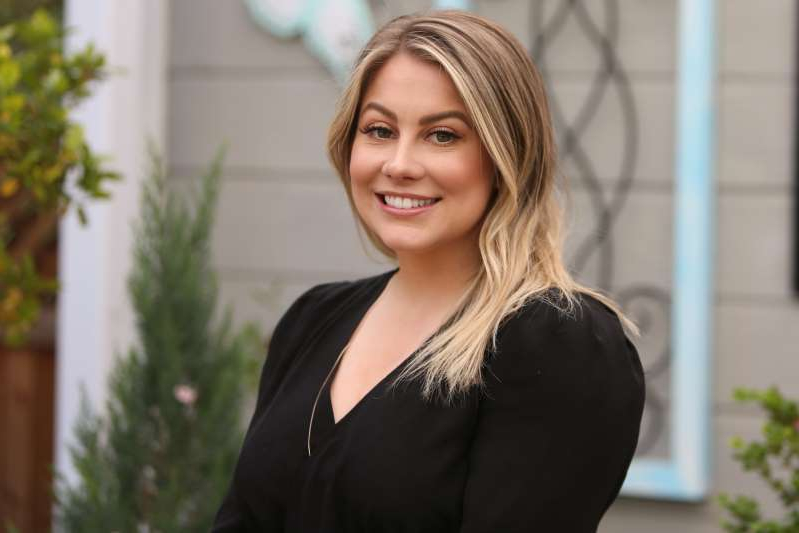 Shawn Johnson standing in front of a building: Shawn Johnson detailed her struggle with body image, Adderall and nutrition after the 2008 Olympics. (Photo by Paul Archuleta/Getty Images)