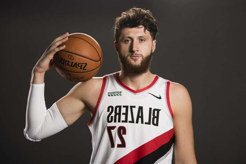 a baseball player holding a basketball: Jusuf Nurkic, 25, is now about 15 months removed from the compound leg fracture he suffered during a game against the Brooklyn Nets during the 2018-19 season.