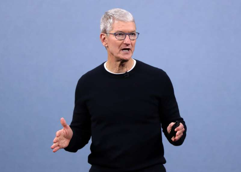 Tim Cook in a blue shirt: CUPERTINO, CALIFORNIA - SEPTEMBER 10: Apple CEO Tim Cook delivers the keynote address during a special event on September 10, 2019 in the Steve Jobs Theater on Apple's Cupertino, California campus. Apple unveiled several new products including an iPhone 11, iPhone 11 Pro, Apple Watch Series 5 and seventh-generation iPad. (Photo by Justin Sullivan/Getty Images)