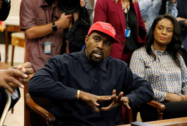 Kanye West et al. sitting at a table: Rapper Kanye West speaks during meeting with U.S. President Trump at the White House in Washington