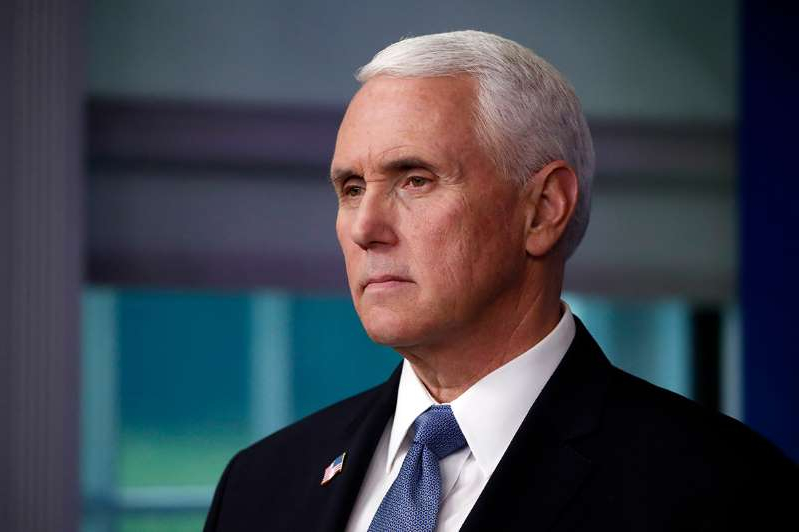 Mike Pence wearing a suit and tie: Vice President Mike Pence.