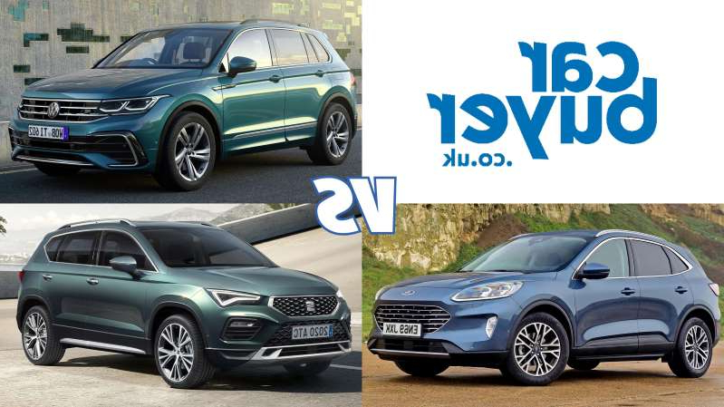 a car parked in a parking lot: New Volkswagen Tiguan vs Ford Kuga & SEAT Ateca: specs comparison