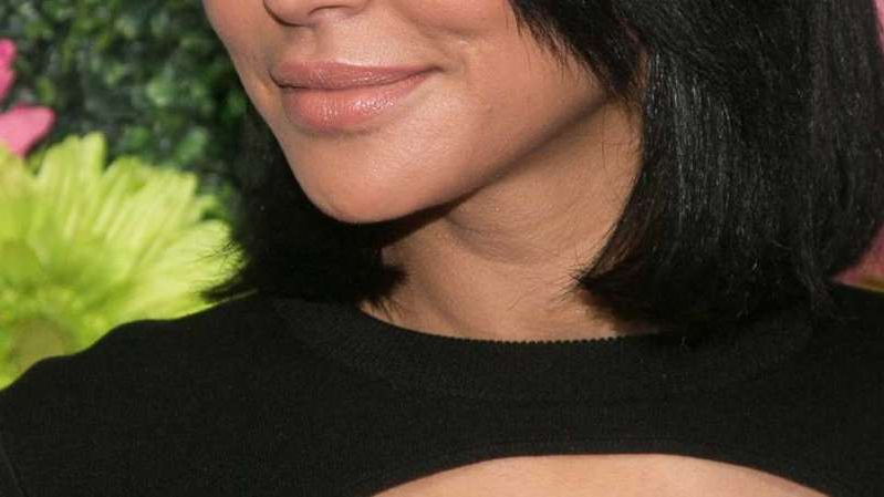 a close up of a person wearing glasses: Naya Rivera