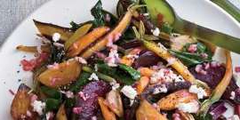 a plate of food with meat and vegetables: Grace Parisi makes a simple, creamy dressing by whisking fresh goat cheese with vinegar and oil; she tosses it with a salad of warm roasted beets and beet greens, which brings us to another good rule: Eat vegetables from root to leaf when possible.