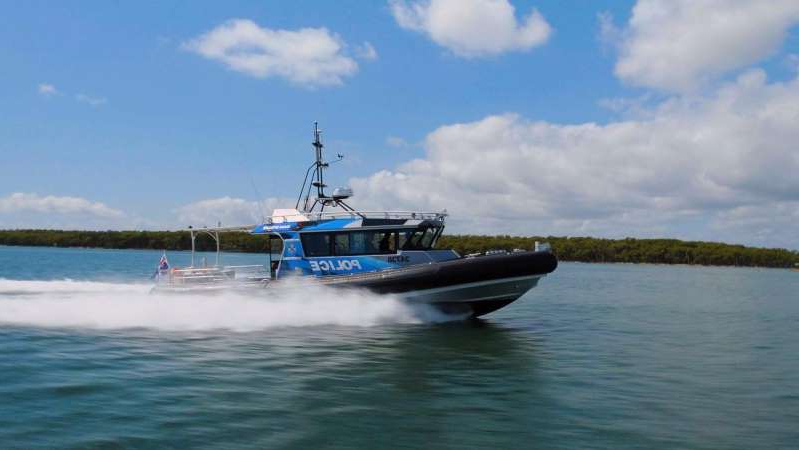 a small boat in a body of water: Generic image of a police boat in the water. (Supplied: Queensland Police Service)
