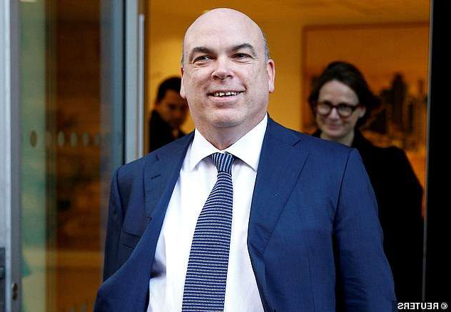 Michael Richard Lynch wearing a suit and tie smiling at the camera: Fighting extradition: Former Deloitte boss Mike Lynch, who is worth an estimated £469m, is facing criminal charges in the US