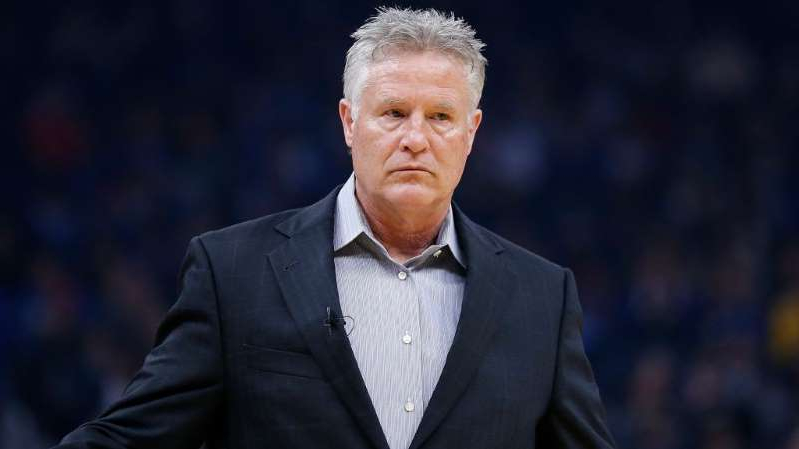 Brett Brown wearing a suit and tie