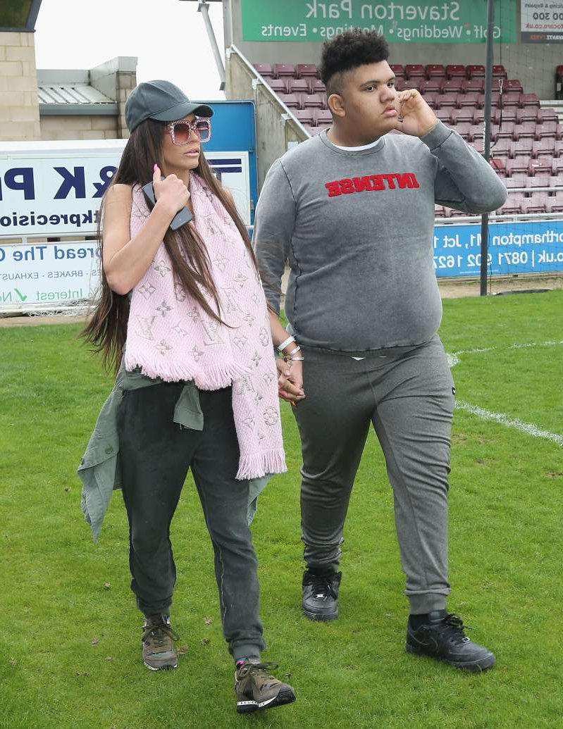 a couple of people that are standing in the grass: Harvey and Katie Price pictured in 2018