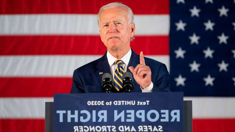 Joe Biden wearing a suit and tie: Democratic presidential candidate Joe Biden speaks about reopening the country during a speech in Darby, Pennsylvania, June 17, 2020.