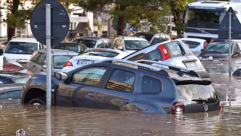 a car parked in the water: The Italian city of Palermo after a surprise summer thunderstorm [Tullio Puglia/Getty Images]