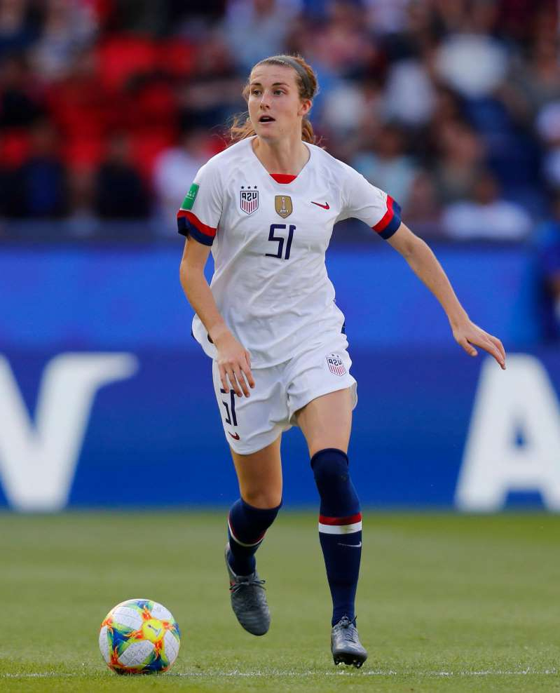 a man holding a football ball on a field: Tierna Davidson is ready to carry on the legacy of the USWNT. And she has no problem standing up for what she believes in on and off the field.