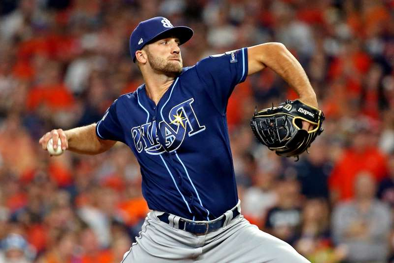 a close up of a man in a baseball uniform throwing a ball: Rays lefty Colin Poche has been diagnosed with a torn ulnar collateral ligament in his left elbow and will miss the 2020 season, the team announced.