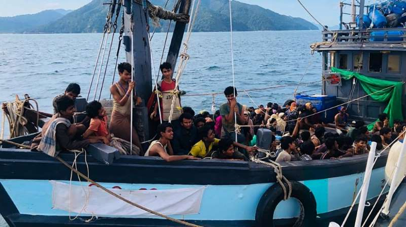 a group of people in a boat on a body of water: The Rohingya were among those detained in April from a boat off Langkawi [Malaysian Maritime Enforcement Agency handout via AFP]