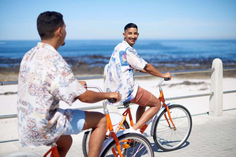 a man riding on the back of a bicycle: A new survey from misterBnB gives insight into how LGBTQI+ travelers are thinking right now.