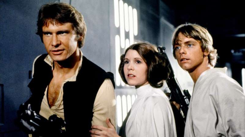 Mark Hamill, Carrie Fisher, Harrison Ford posing for the camera: null
