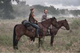 a person riding a horse in a field: fear the walking dead ftwd season 6 premiere and trailer