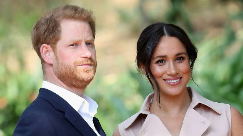 Meghan Markle, Prince Harry smiling for the camera