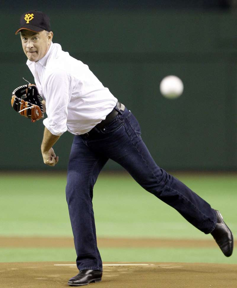 a baseball player throwing a ball: Tom Hanks throws out a first pitch in Japan in 2009.