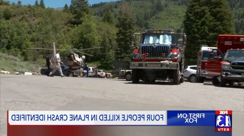 a truck that has a sign on the side of a road: Among those killed were the pilot and his 9-month-old son