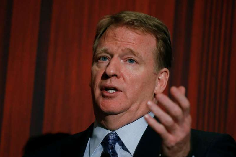 Roger Goodell wearing a suit and tie smiling and looking at the camera: NFL commissioner Roger Goodell addresses the Economic Club of New York luncheon in Manhattan, New York
