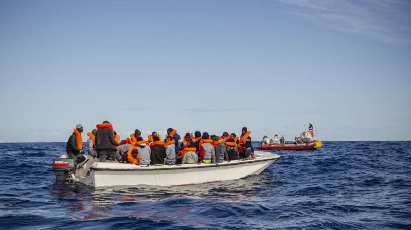 a group of people riding on the back of a boat in the water: UN figures show that at least 36,000 people have been intercepted by the Libyan coastguard and returned to the North African country since February 2017 [File: Faras Ghani/Al Jazeera]
